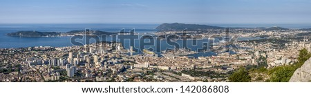 Ferry arriving from Corsica in the harbour of Toulon, right in front of the aircraft carrier Charles de Gaulles - stock photo
