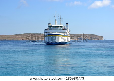 Ferry arriving to the port in Malta from Gozo, in Cirkewwa, Malta - May 8, 2014. This ferry daily transports passengers and cars between islands of Malta and Gozo in Mediterranean sea.