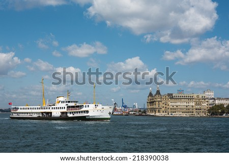 Ferry boat sails into port of Haydarpasa station building, Istanbul, TURKEY - stock photo