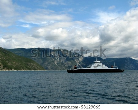 ferry crossing the fjord - stock photo