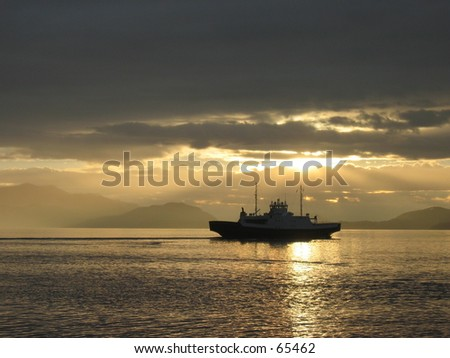 Ferry crossing the fjord. - stock photo
