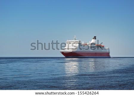 Ferry entering port of Riga - stock photo