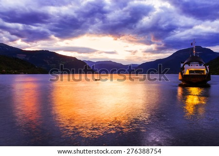 Ferry in fjord Hardanger Norway - nature and travel background - stock photo