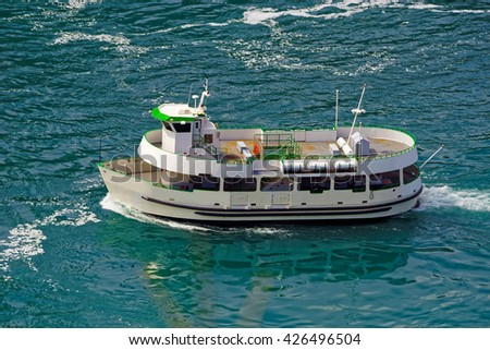 Ferry in the waters of Niagara River. A view from American side. Niagara River is a river from Lake Ontario to Lake Erie. It is a natural border between Canada and the USA.