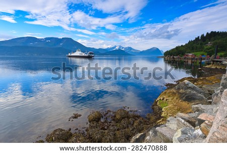 Ferry landing MagerHolm near Alesund in the Storfjord fjord on the summer morning, Norway