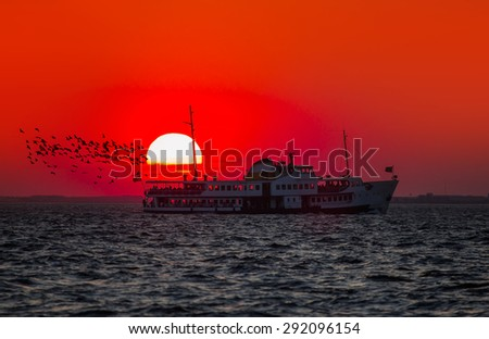 ferry services in the Gulf of Izmir at sunset - stock photo