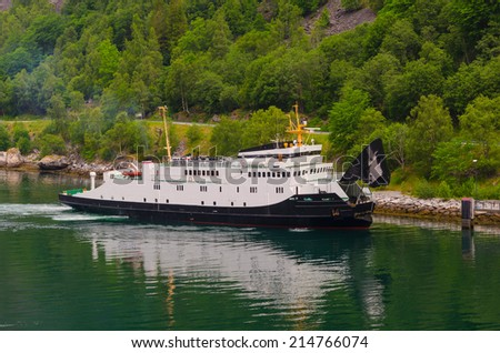 Ferry ship in the norwegian fjords. Transport ship - stock photo