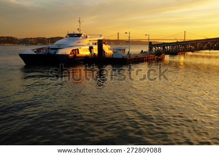 Ferryboat docked ina pier in Lisbon at Sunset - stock photo