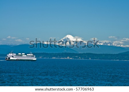 Ferryboat in the Puget Sound with Mount Baker in the background in Washington state on a beautiful sunny day - stock photo