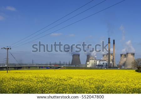 FERRYBRIDGE POWER STATION WITH FIELD OF RAPE SEED AND M62 MOTORWAY YORKSHIRE ENGLAND