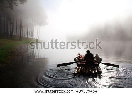 Ferryman, Pang Oung in thailand with the winter.  And with the light and shadow and steam over the lake in meahongson,Thailand
