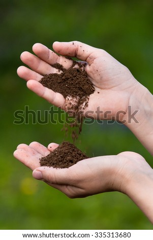 fertile soil in hands  - stock photo