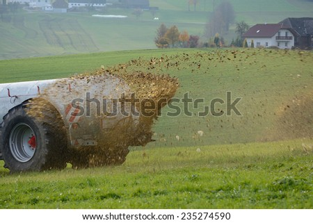 Fertilize a lawn with manure - stock photo