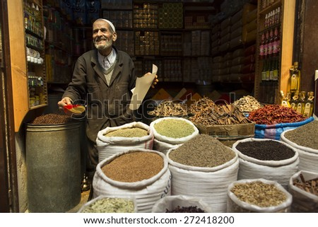 FES, MOROCCO, April 19: Unkown man selling condiments in traditional store in Fes, Morocco on 19 April 2015. FEZ is the Unesco World Heritage Site - stock photo