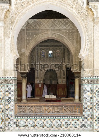 FES, MOROCCO- JULY 18: Ornate carving on the plastered walls and on the woodwork in the courtyard of the Madrasa Bou Inania in the ancient medina of Fes as on July 18, 2014 in Fes, Morocco. - stock photo