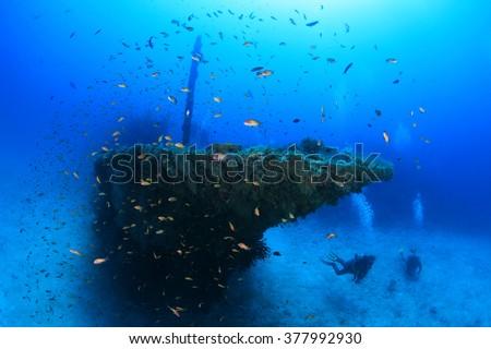 Fesdu shipwreck with scuba divers - stock photo