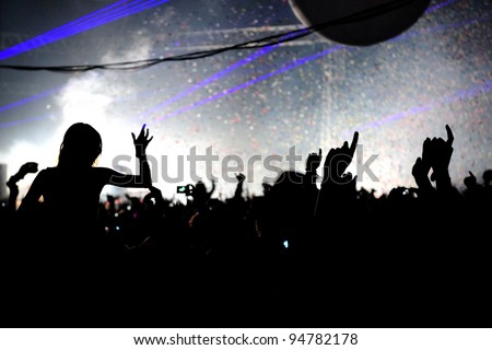 Festival Crowd Girl On Shoulders Hands In Air - stock photo