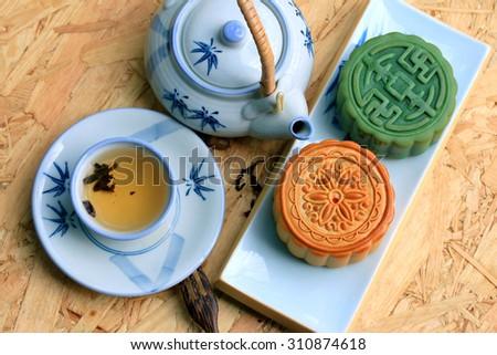 Festival moon cake and hot tea - Chinese cake - stock photo