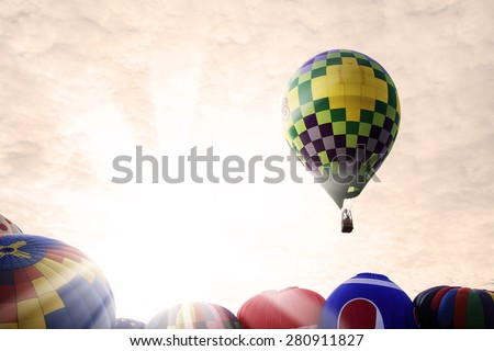 Festival of hot air balloons in the glow of the morning sun.