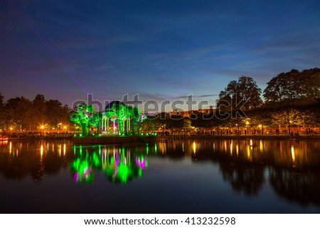 Festival of lights in city park, pond with illuminated rotunda. Tallinn, Estonia - stock photo