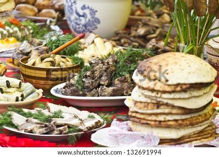 festive abundance of food on the table - stock photo