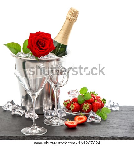 festive arrangement with champagne, red rose and strawberries over white background - stock photo