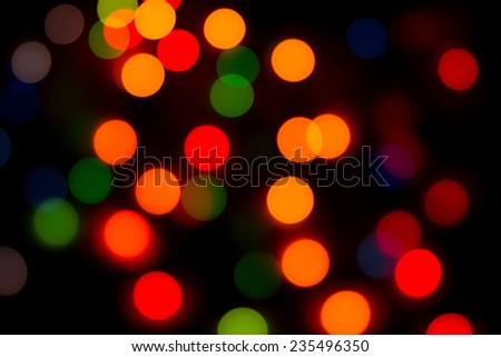 Festive background with blurred circles of different colors