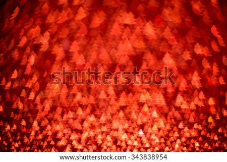Festive background with christmas tree. Abstract twinkled bright background with bokeh defocused lights