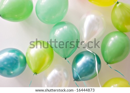 Festive balloons floating on the ceiling - landscape exterior - stock photo