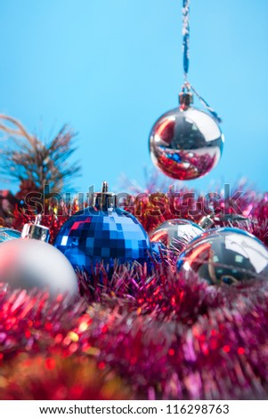 festive balls and toys for new year on the blue background