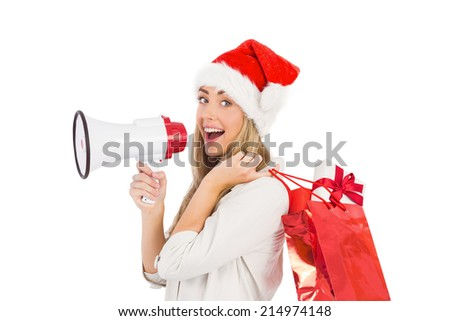Festive blonde holding megaphone and bags on white background - stock photo
