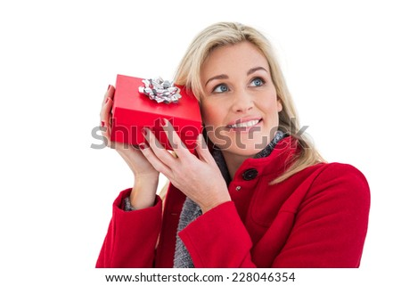 Festive blonde holding red gift on white background
