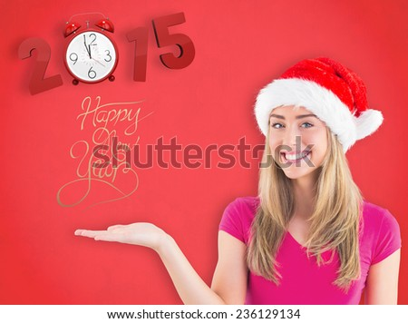 Festive blonde presenting with hand against red background