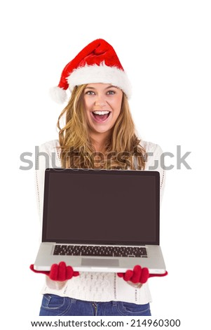 Festive blonde showing a laptop on white background