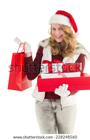 Festive blonde with shopping bag and gifts on white background