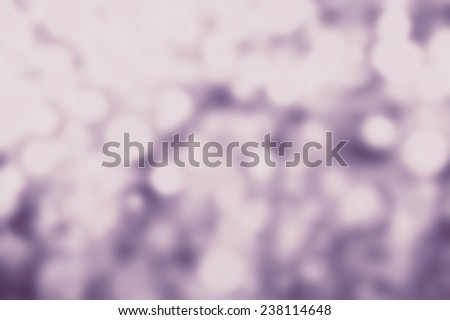 Festive blur background with natural bokeh and bright golden lights. Abstract Christmas twinkled bright background with boke defocused white and purple  lights  - stock photo