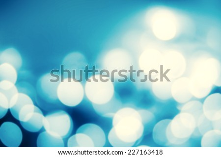 Festive blur background with natural bokeh and bright silver lights. - stock photo