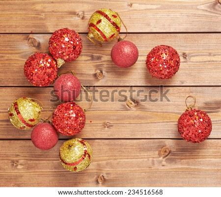 Festive Christmas and New Year background composition of multiple decoration balls over the wooden background - stock photo