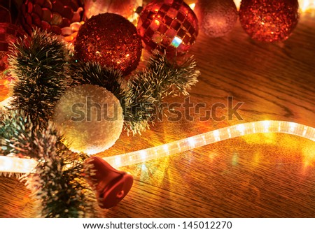 Festive Christmas background as a xmas decorations hightlightened with a garland