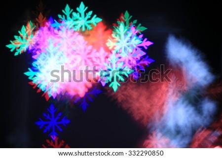 Festive Christmas Background - bokeh of snow flake - stock photo