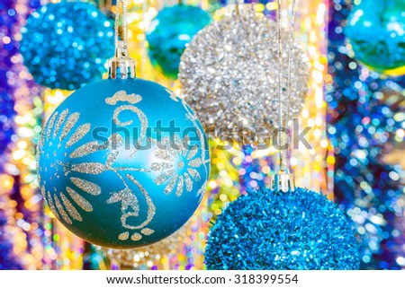 Festive Christmas blue and silver balls on a soft background bokeh, close-up. Selective focus - stock photo