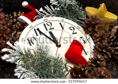 Festive Christmas card with a clock and fir branches