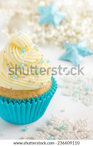 Festive Christmas cupcakes with frosting and sugar decoration - stock photo