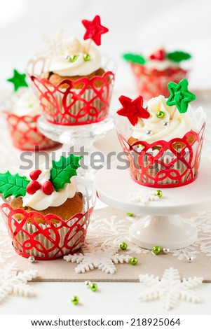 Festive Christmas cupcakes with vanilla frosting and sugar decoration