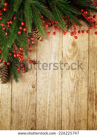 Festive Christmas fir tree on wooden background with space for your text