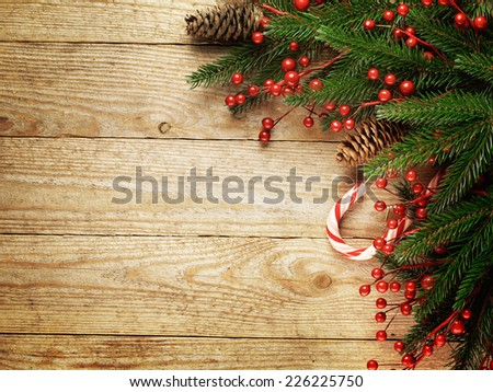 Festive Christmas fir tree on wooden background with space for your text - stock photo
