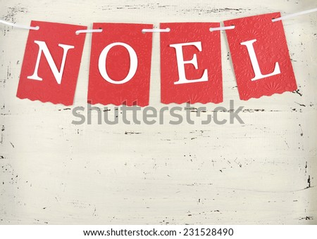 Festive Christmas Holiday background with red and white theme Noel bunting letters on vintage shabby chic white wood background. - stock photo
