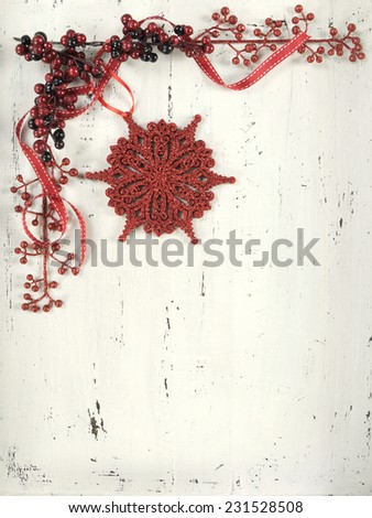 Festive Christmas Holiday background with red and white theme snowflake ornament on vintage shabby chic white wood background. - stock photo