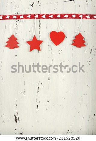 Festive Christmas Holiday background with red and white theme wood decorations on vintage shabby chic white wood background. - stock photo