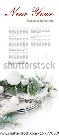 Festive Christmas table setting, table decoration in white, with fir branches, Christmas balls on a white background, isolated - stock photo